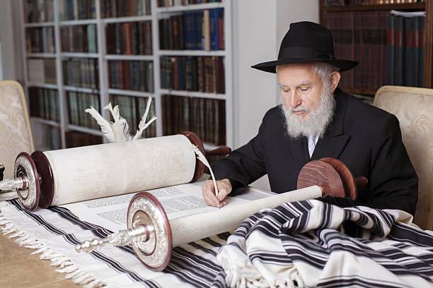 Scribe writing a Torah stock photo