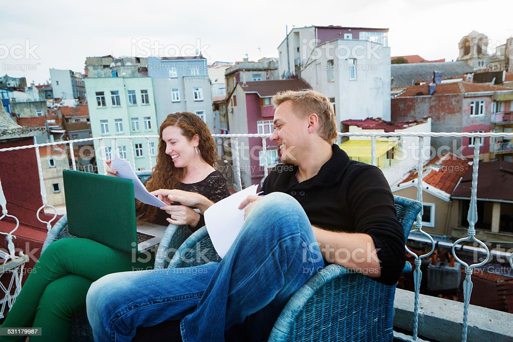 Script writers enjoying revisions on rooftop set stock photo