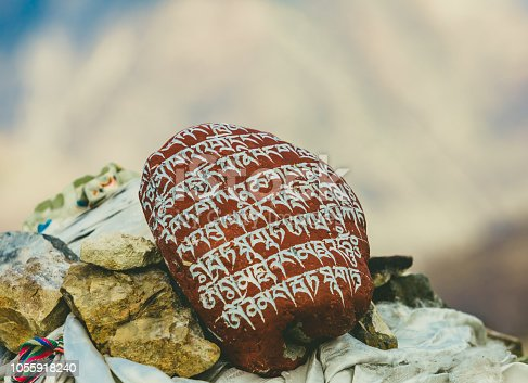 Scripture carve in stone on mountain
