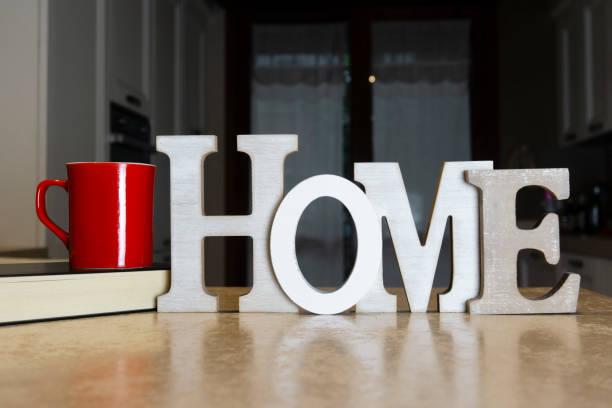 scritta home scritta home con tazza e libro libro stock pictures, royalty-free photos & images