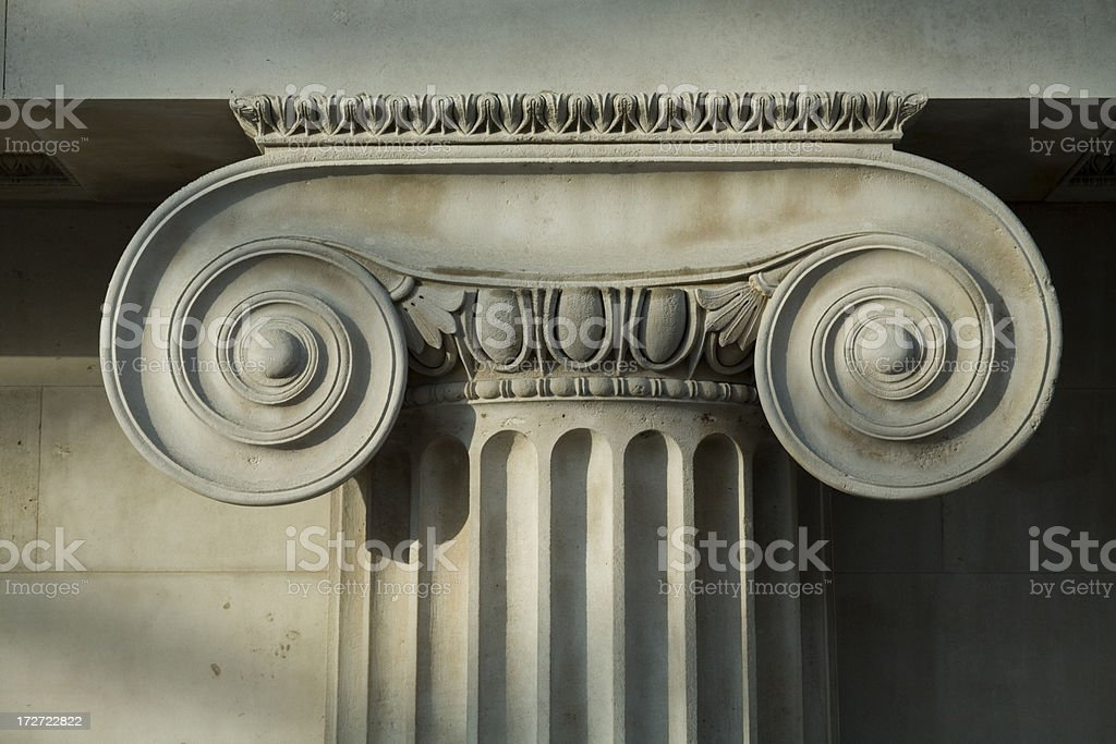 Scrolled Stone Column. stock photo
