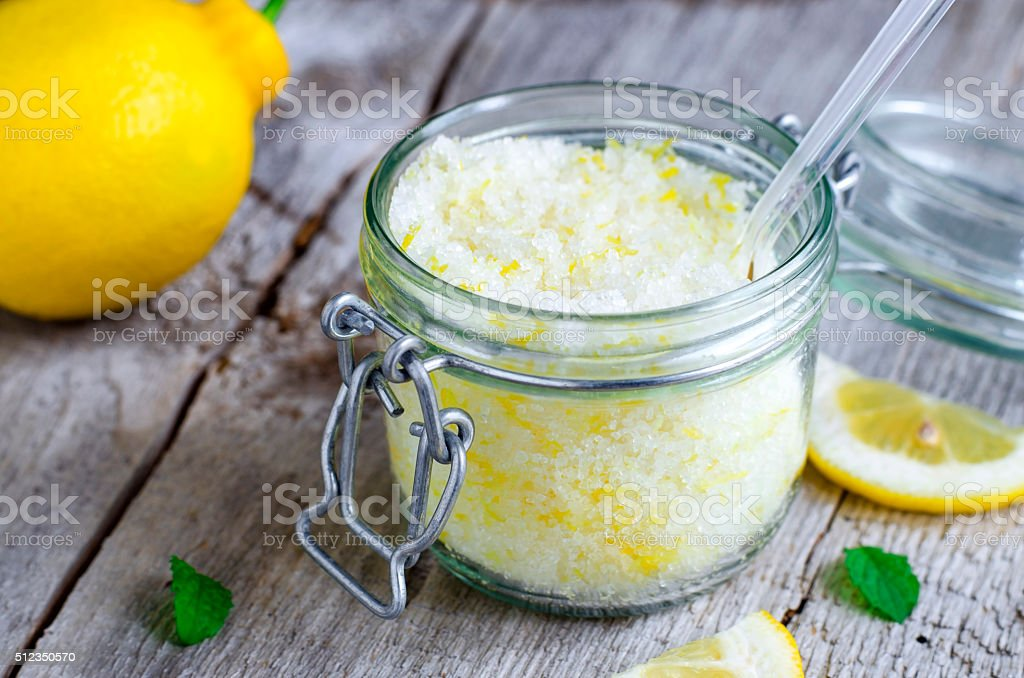 Scrub made of sea salt, lemon peel and lemon juice stock photo