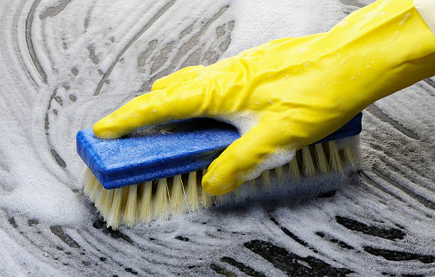 Scrubbing Scrubbing the floor with a brush and rubber gloves scrubbing brush stock pictures, royalty-free photos & images