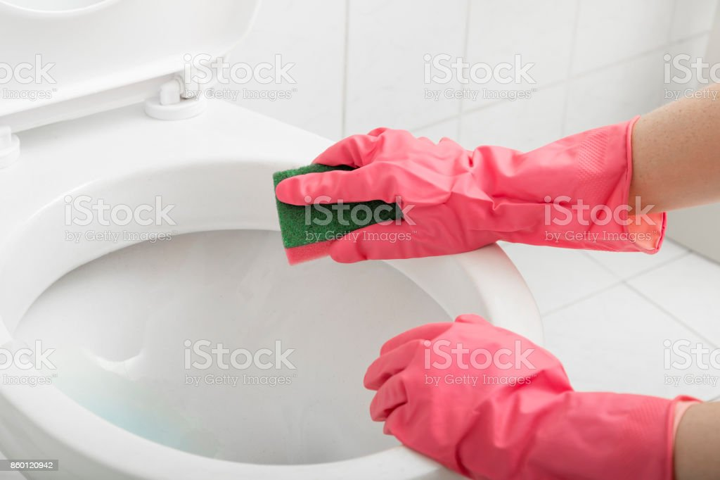 Scrubbing toilet stock photo