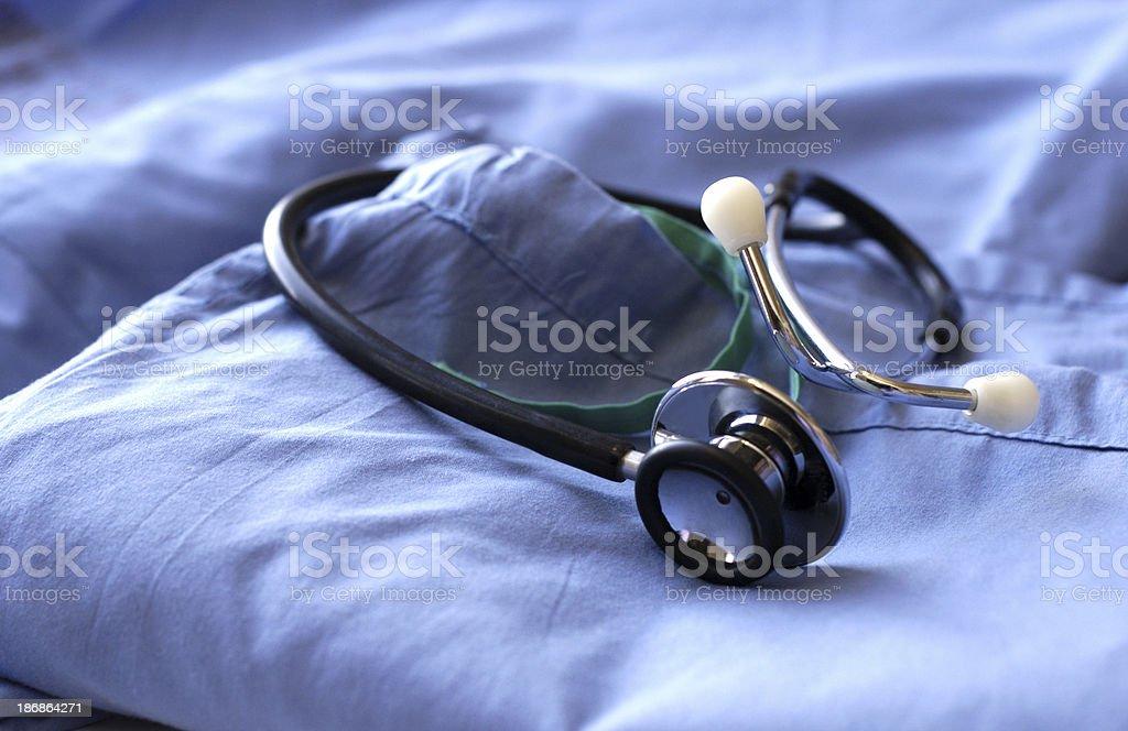 scrubs and stethoscope stock photo