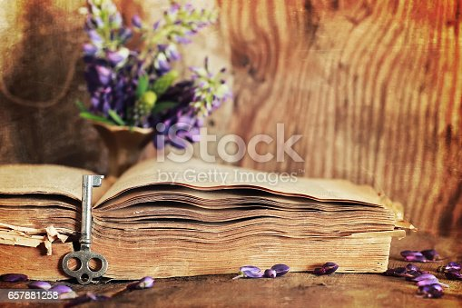 istock sctrathes effect on photo retro book on wooden table key 657881258