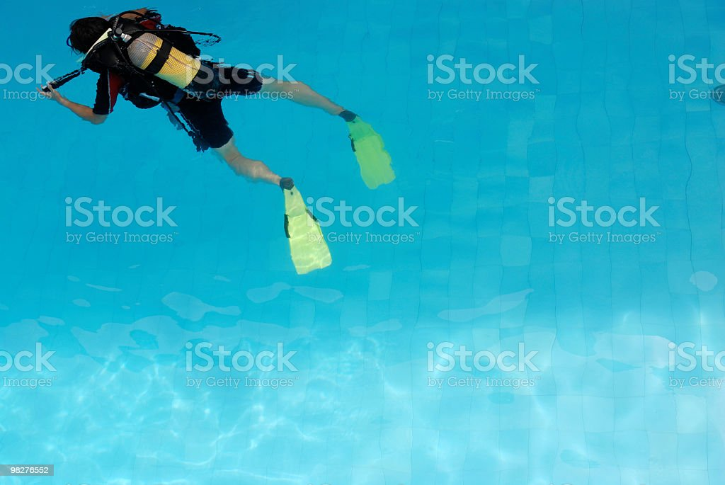 scuba dive lessons in the pool with copy space royalty-free stock photo