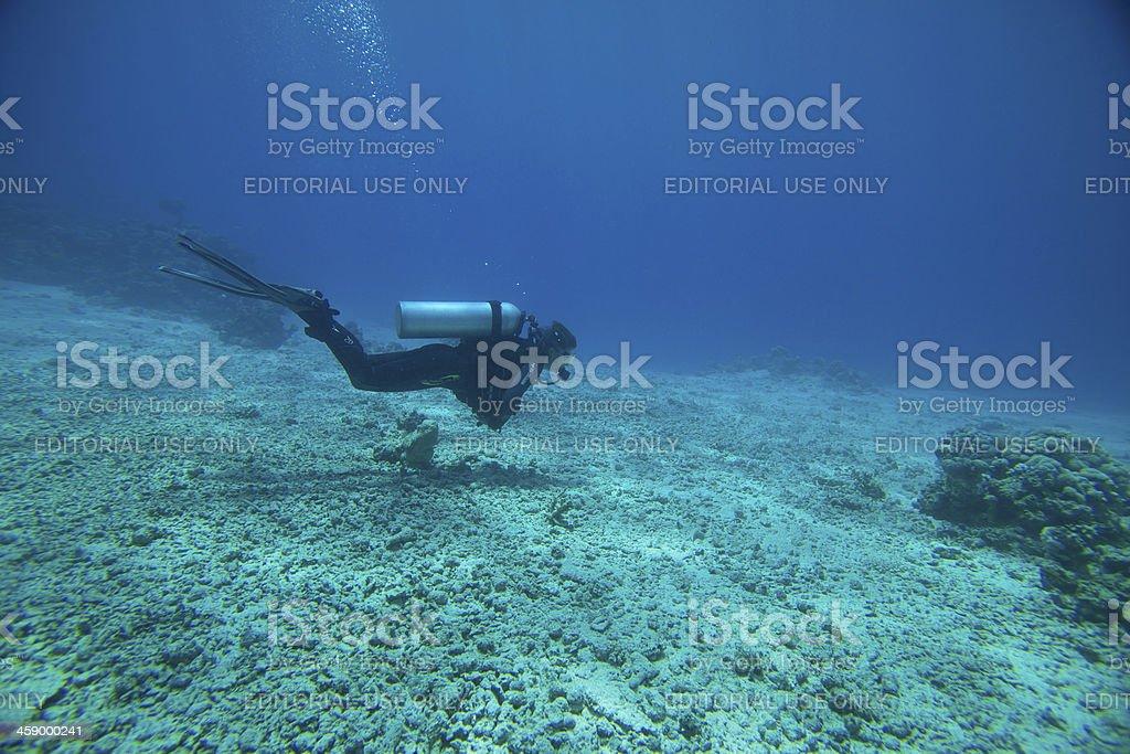 Scuba diver at ten meters decompression stop stock photo