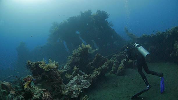 Scuba diver diving in shipwreck USAT Liberty, Bali, Indonesia stock photo