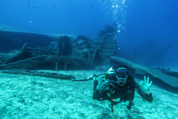 scuba diver during a wreck dive in greece - shipwreck stock pictures, royalty-free photos & images