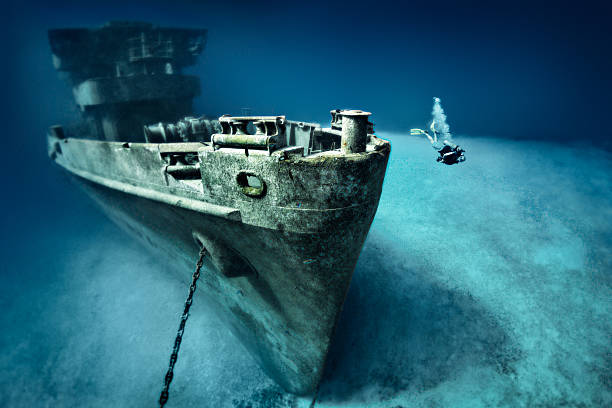 scuba diver exploring ship wreck - shipwreck stock pictures, royalty-free photos & images