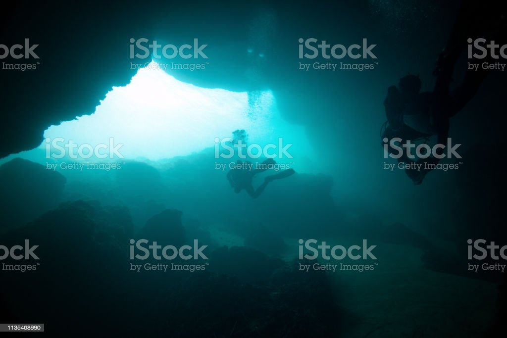 Scuba diver in cave diving stock photo