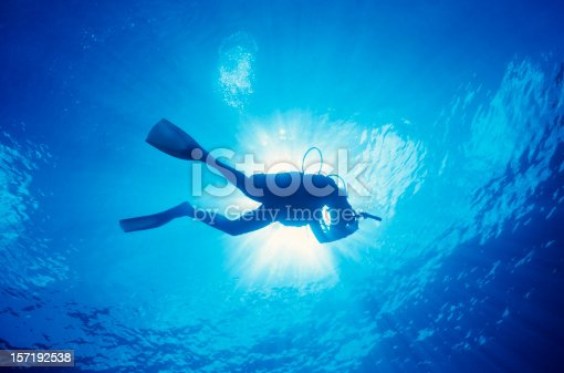 istock Scuba diver in the water with the sun above 157192538