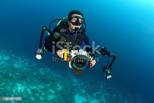Scuba diver with a camera with underwater housing ready to take some pictures.