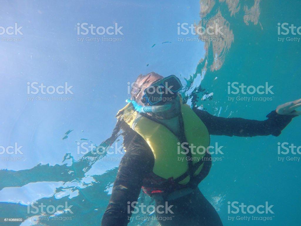 Scuba Diver Underwater taking a selfie in Whitsundays, Australia royalty-free stock photo