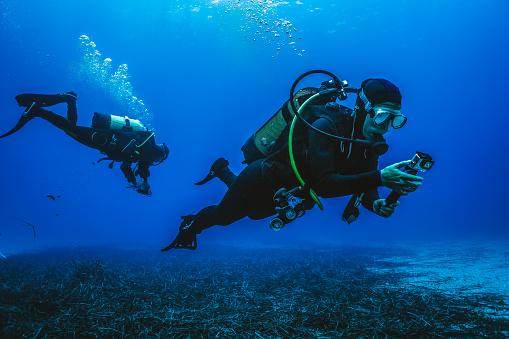 He films it on his underwater camera