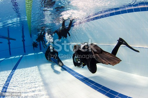 Scuba divers swimming and training