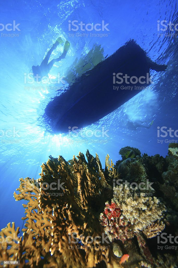 Scuba diving boat and coral reef - Royalty-free Blue Stock Photo