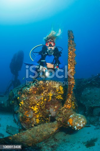 Scuba diving Exploring and enjoying Wreck diving over a B-24 Liberator Bomber Wreck Sea life  Sporting women long blonde hair  Water sports  Scuba diver point of view.  Vis, Adriatic Sea, Croatia.