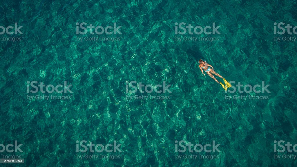 Scuba diving in turquise waters stock photo