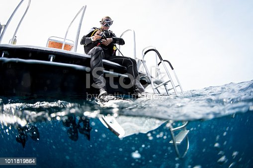 Scuba diver on the boat before diving in the Carrebbean sea near Cayman Islands.