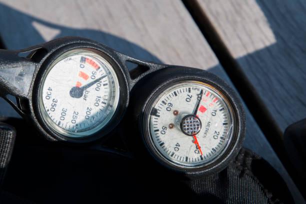 Scuba diving pressure and depth gauge stock photo