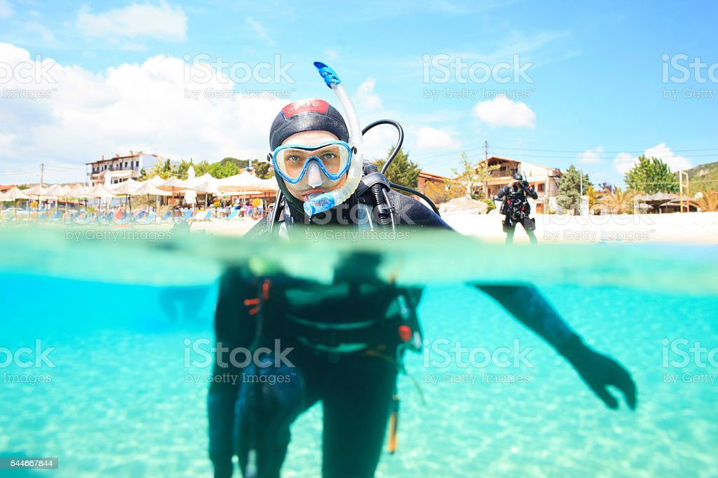 Scuba diving    Scuba diver in blue lagoon stock photo