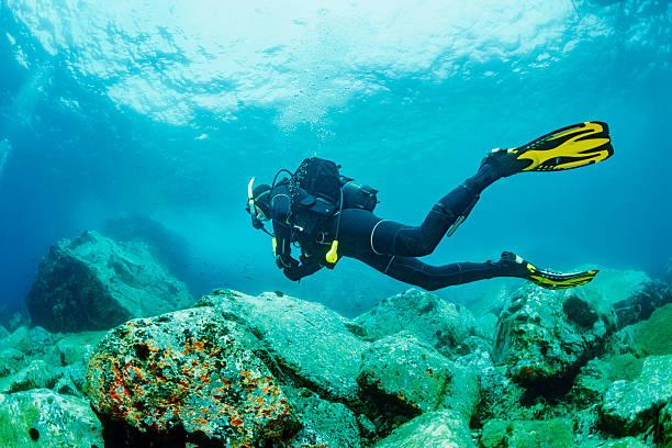 Scuba diving    Underwater  scuba diver in blue lagoon stock photo
