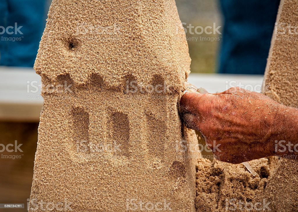 Sculpting a Sandcastle royalty-free stock photo