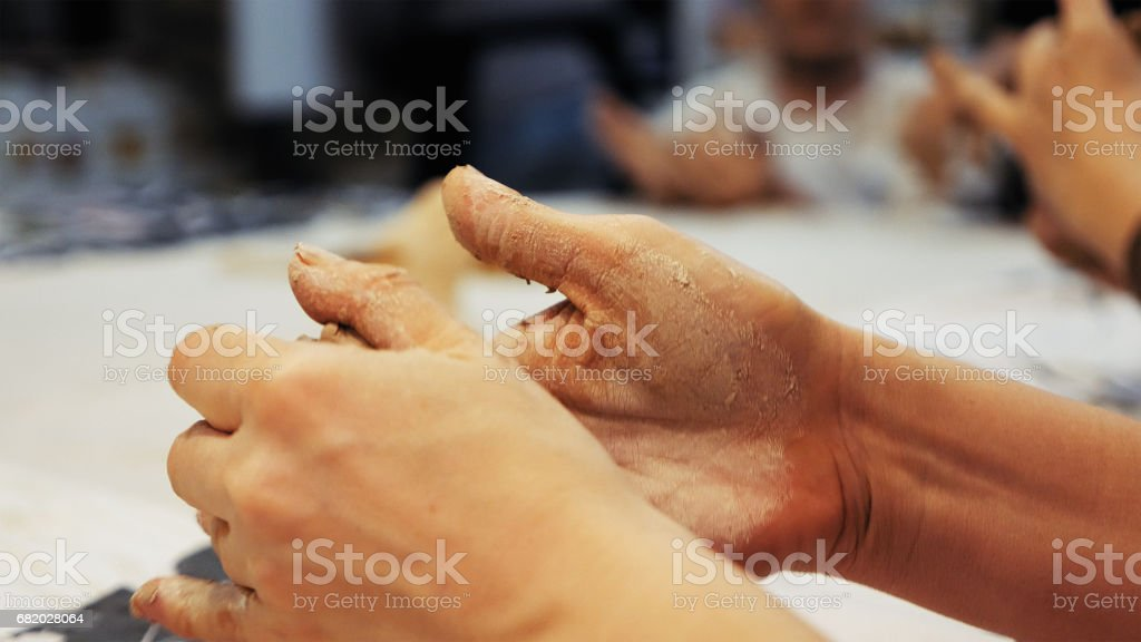 Sculptor Is Pugging Clay For Creating Pottery Stock Photo More