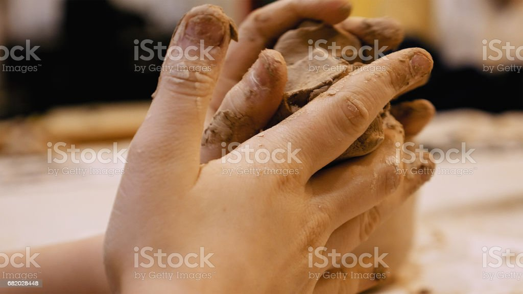Sculptor is pugging clay for creating pottery stock photo
