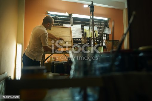 istock Sculptor Painter Artist Chiseling A Wooden Bas Relief-1 506240636
