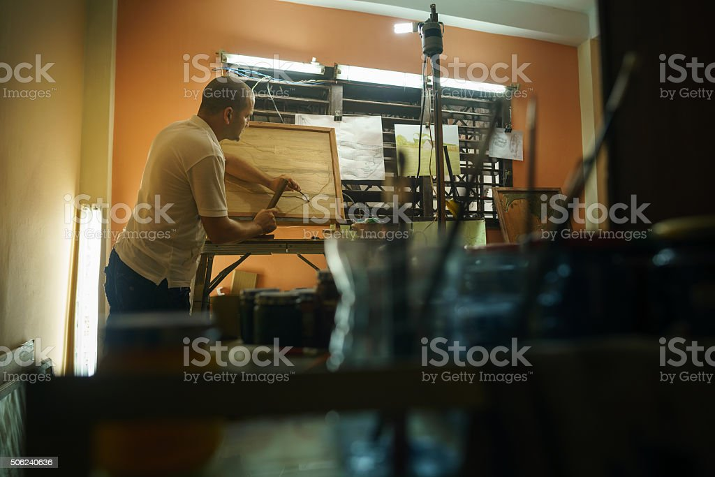 Sculptor Painter Artist Chiseling A Wooden Bas Relief-1 stock photo