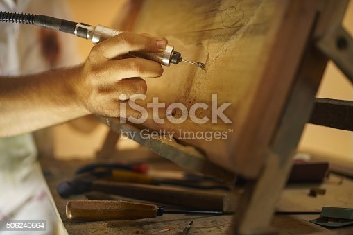istock Sculptor Painter Artist Chiseling A Wooden Bas Relief-2 506240664