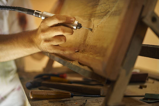sculptor painter artist chiseling a wooden bas relief-2 - woodcut stock photos and pictures