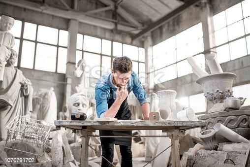 istock Sculptor working in the studio 1076791702