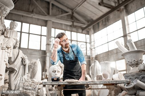istock Sculptor working in the studio 1076791822