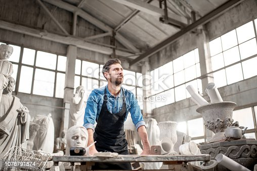 istock Sculptor working in the studio 1076791874