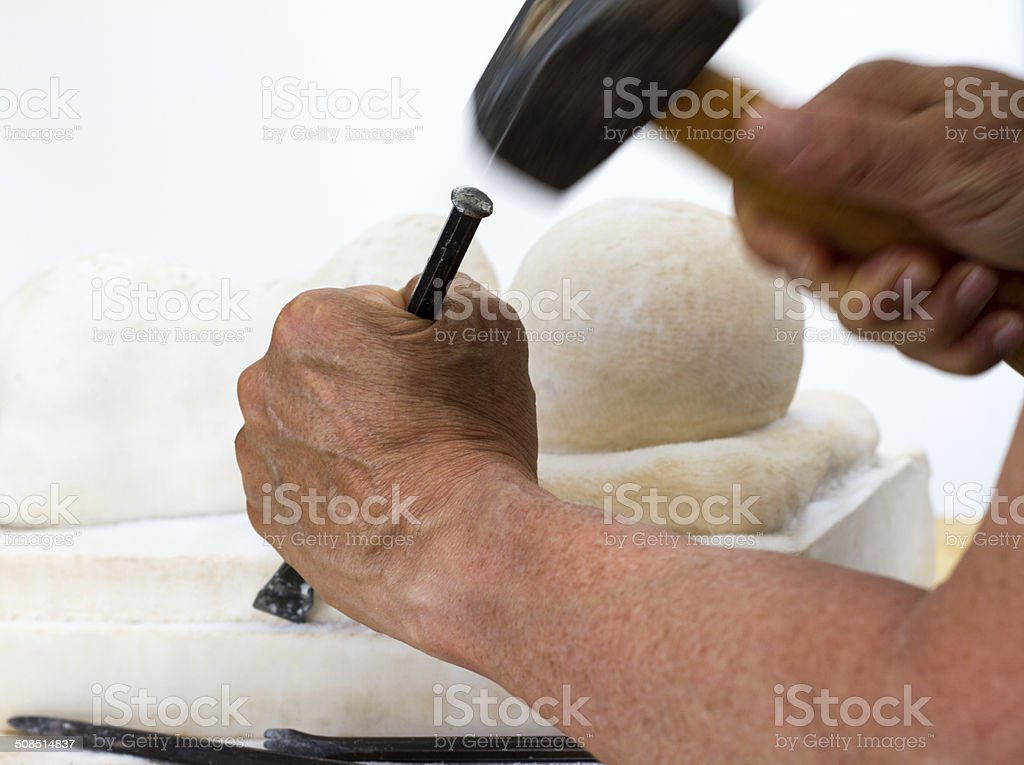 Sculptor Working on Marble Sculpture (Close-Up) stock photo