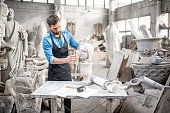 Sculptor working with sculpture in the studio