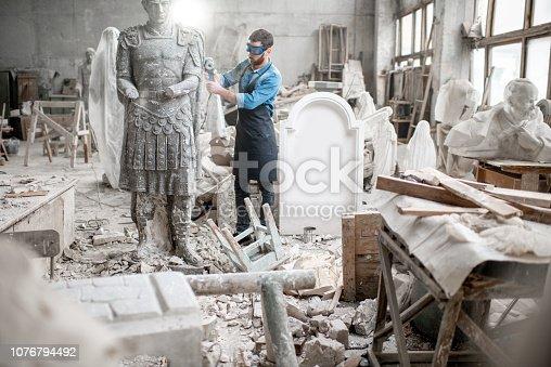 istock Sculptor working with sculpture in the studio 1076794492