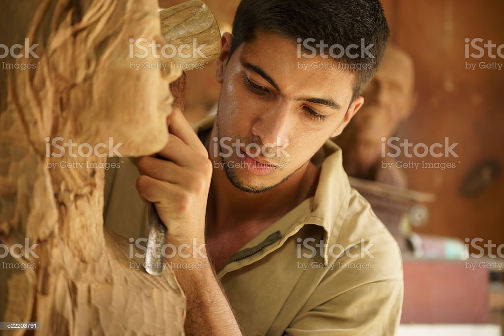 Sculptor young artist artisan working sculpting sculpture stock photo