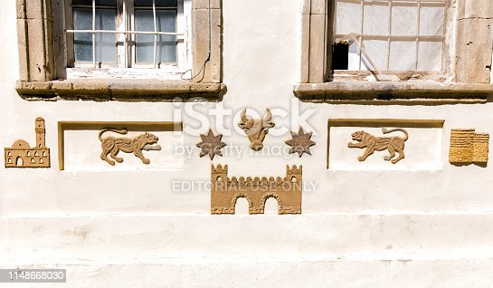 Baku, Azerbaijan - September 09, 2018: Sculptural image of bull and lion on the wall of residential building. Baku. Republic of Azerbaijan