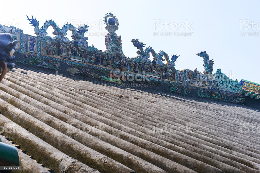 sculpture figures on the roof top of a house stock photo
