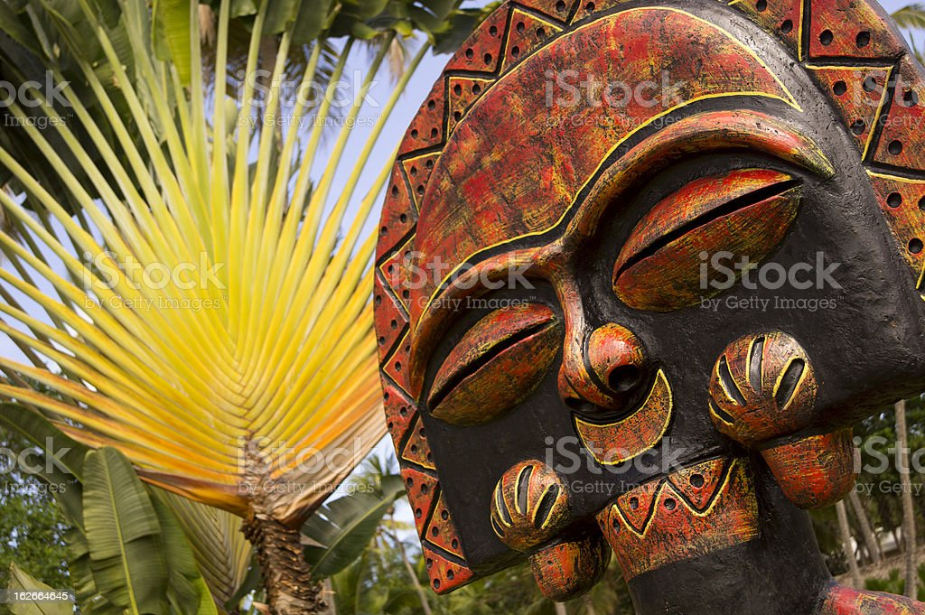Sculpture from the dominican republic on palm trees backgound stock photo