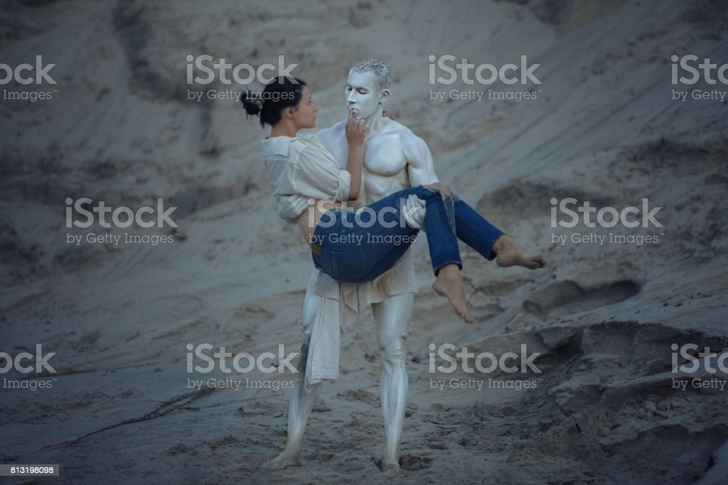 Sculpture of a man is holding a woman. stock photo