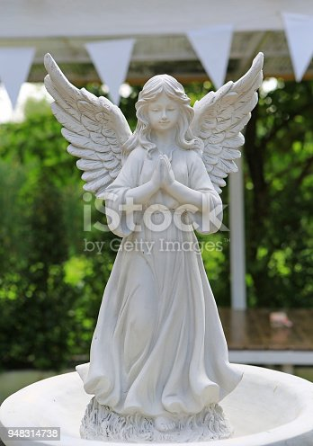 istock Sculpture of an angel in the garden. 948314738