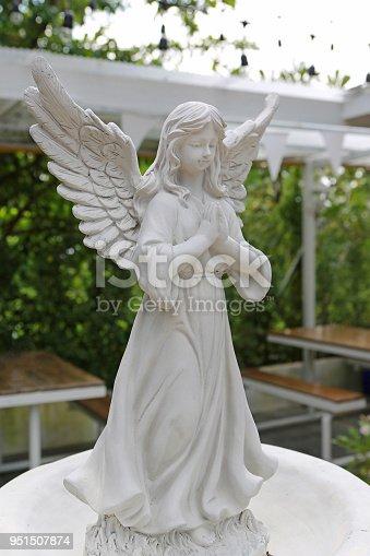 istock Sculpture of an angel in the garden. 951507874