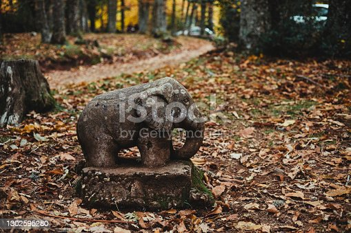 elephant sculpture in the middle of the autumn forest