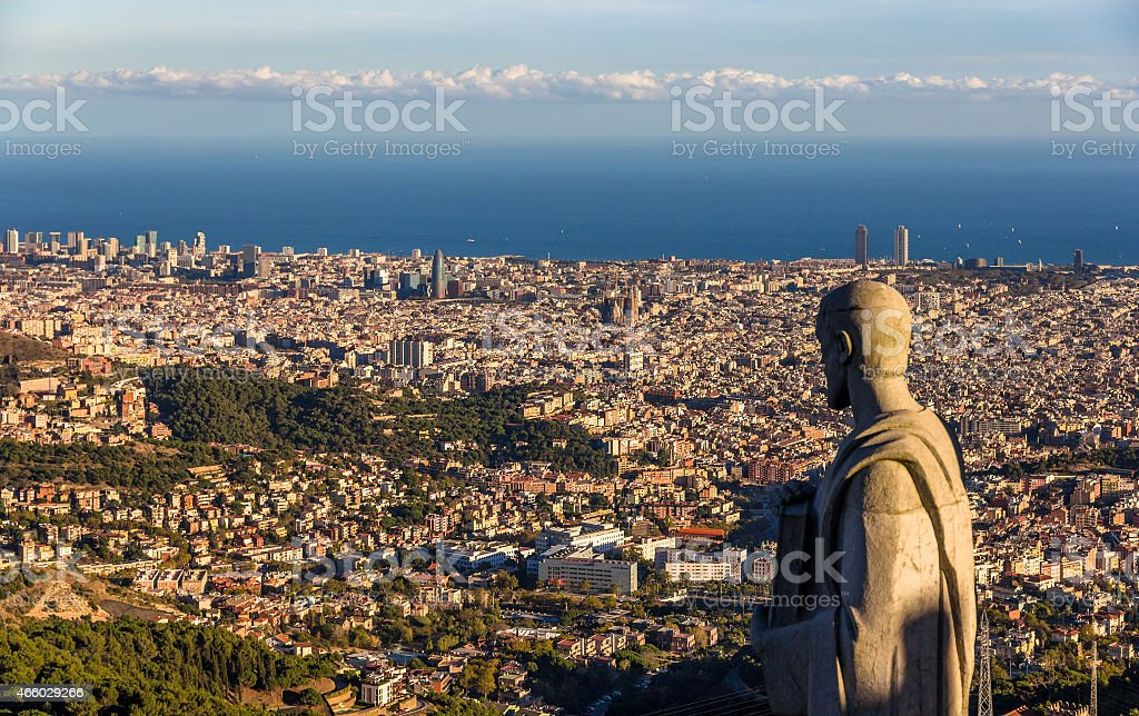 Sculpture of Apostle and view of Barcelona stock photo